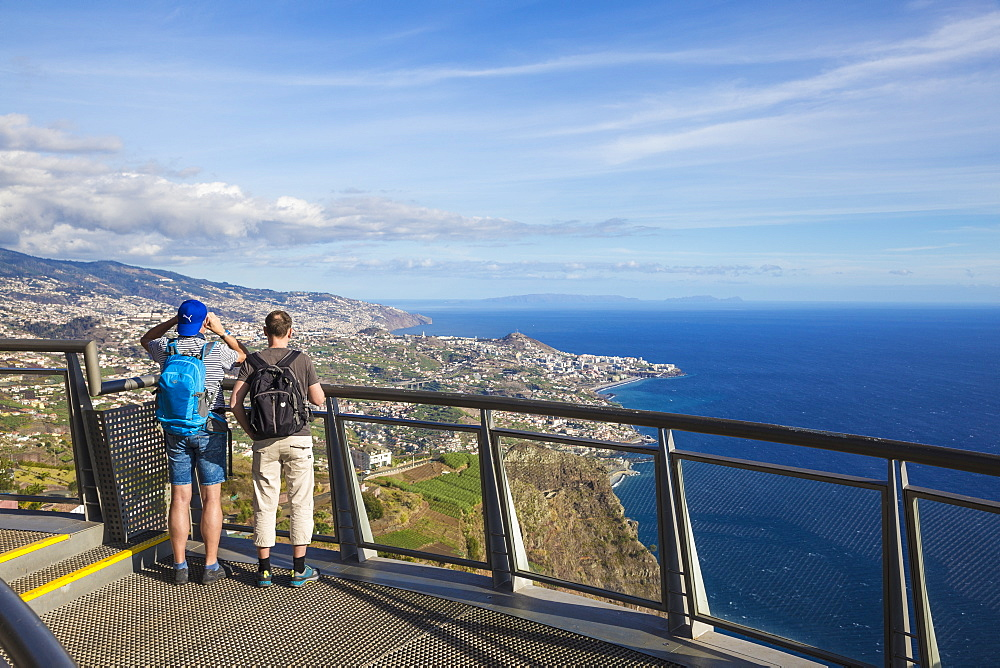 Portugal, Madeira, Funchal, Cabo Girao, Tourist look at view from glass bottomed skywalk