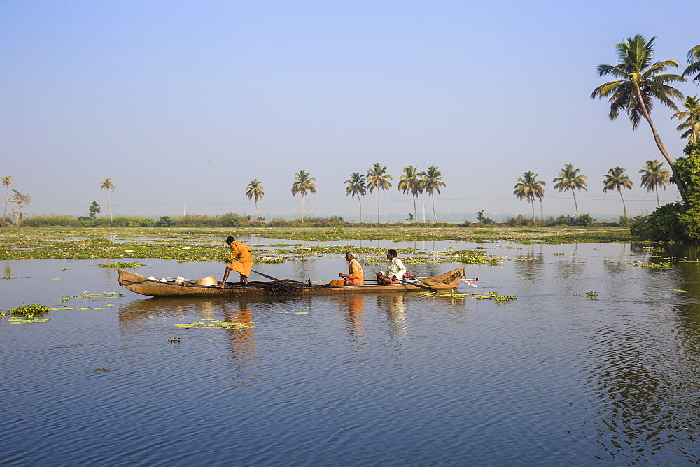 Men fishing from dugout canoe, Backwaters, Alappuzha (Alleppey), Kerala, India, Asia