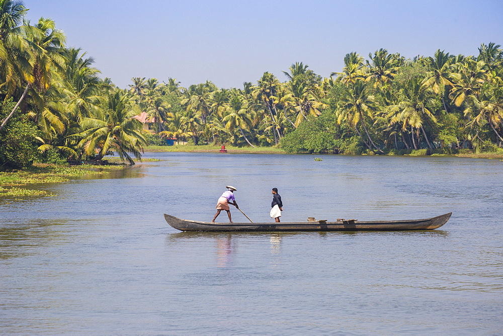 Men in dugout canoe, Backwaters, Kollam, Kerala, India, Asia