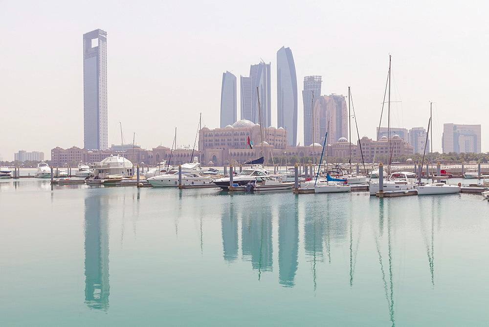 City skyline looking towards the Emirates Palace Hotel and Etihad Towers, Abu Dhabi, United Arab Emirates, Middle East