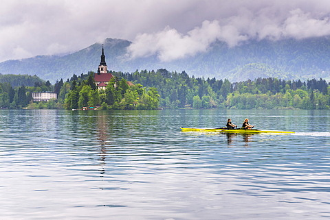 Canoeists on Lake Bled, Julian Alps, Gorenjska, Slovenia, Europe