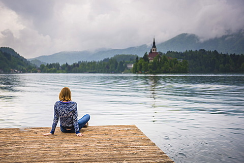 Woman looking at view, Lake Bled, Julian Alps, Gorenjska, Slovenia, Europe