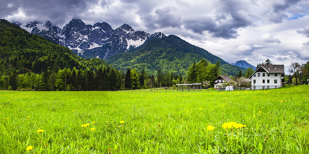 House below the Juilan Alps just outside Kranjska Gora, Triglav National Park, Upper Carniola, Slovenia, Europe
