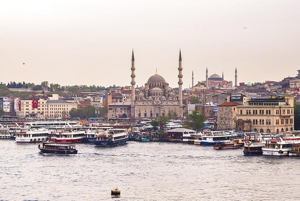New Mosque (Yeni Cami) with Hagia Sophia (Aya Sofya) behind seen across the Golden Horn, Istanbul, Turkey, Europe