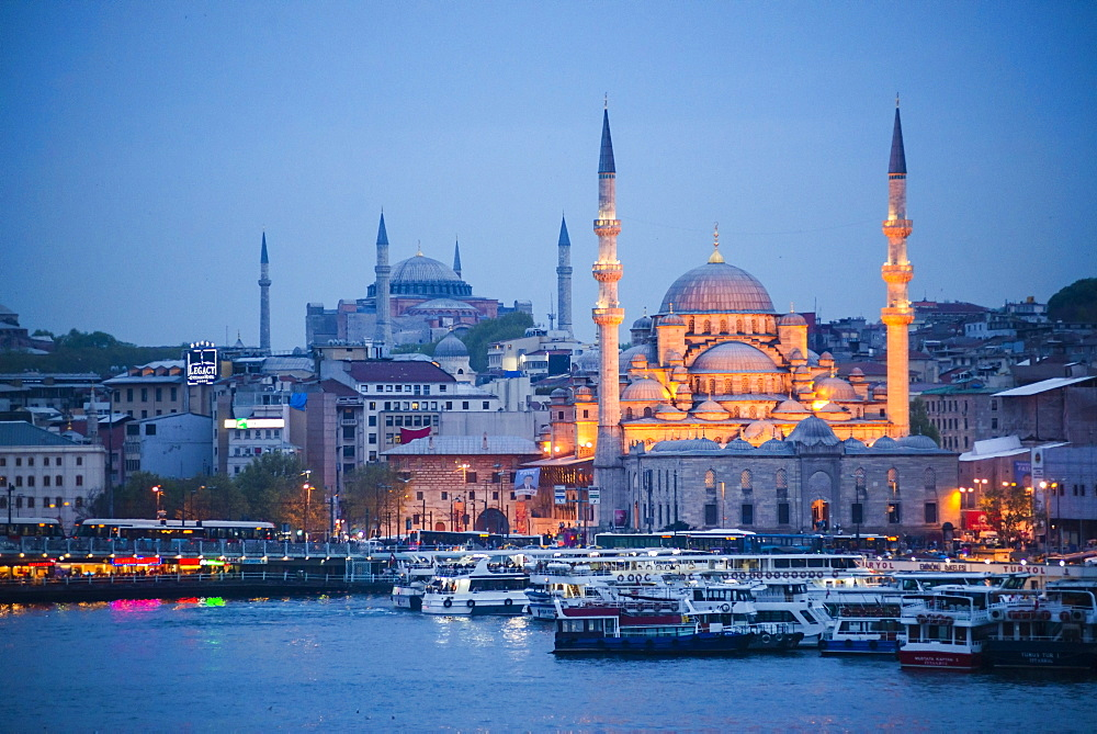 New Mosque (Yeni Cami) at night with Hagia Sophia (Aya Sofya) behind seen across the Golden Horn, Istanbul, Turkey, Europe