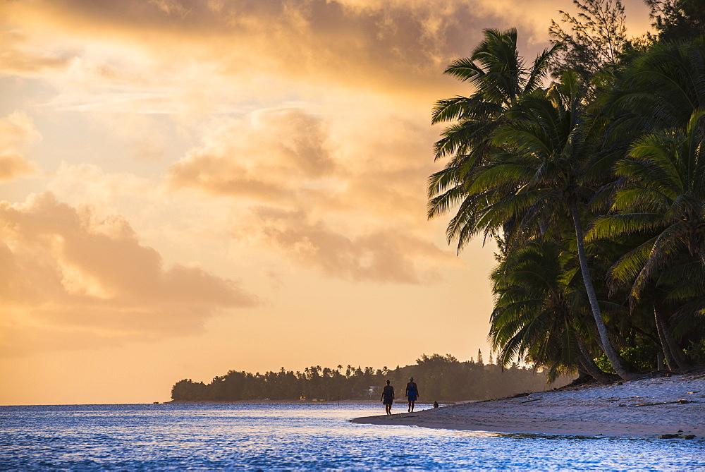 Walking along a tropical beach at sunset, Rarotonga, Cook Islands, South Pacific, Pacific
