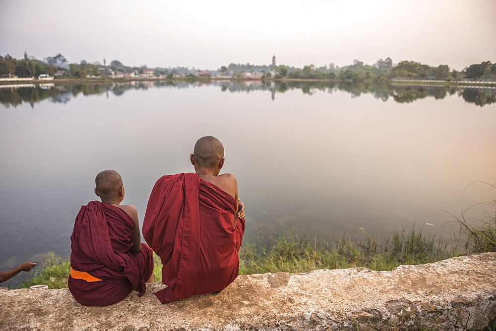 Buddhist Monks at Kandawgyi Lake at sunset, Pyin Oo Lwin (Pyin U Lwin), Mandalay Region, Myanmar (Burma), Asia