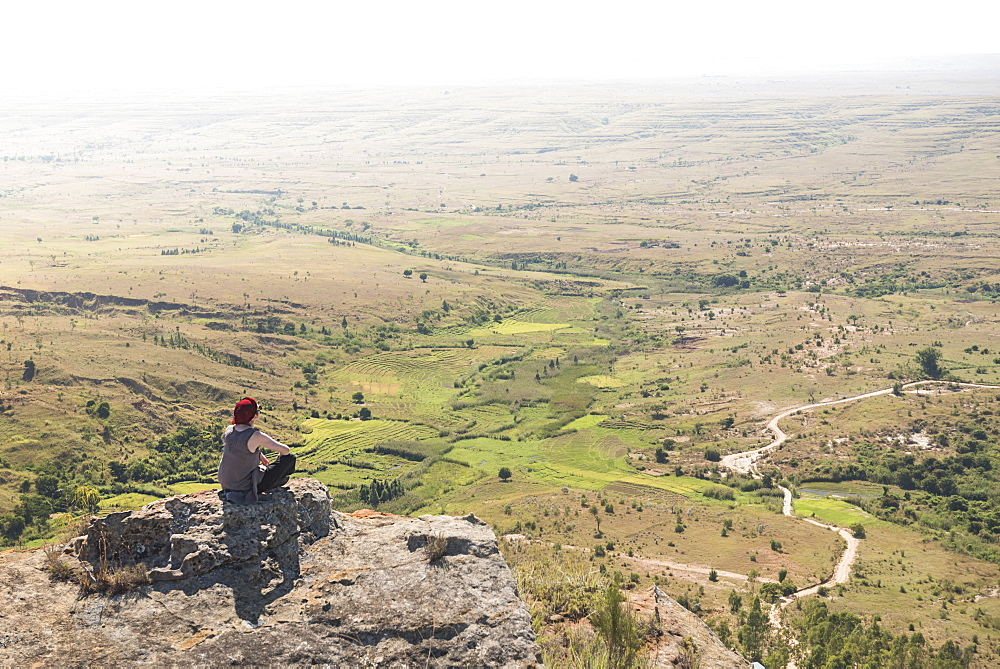 Tourist in Isalo National Park looking over Ihorombe Plains, Southwest Madagascar, Africa
