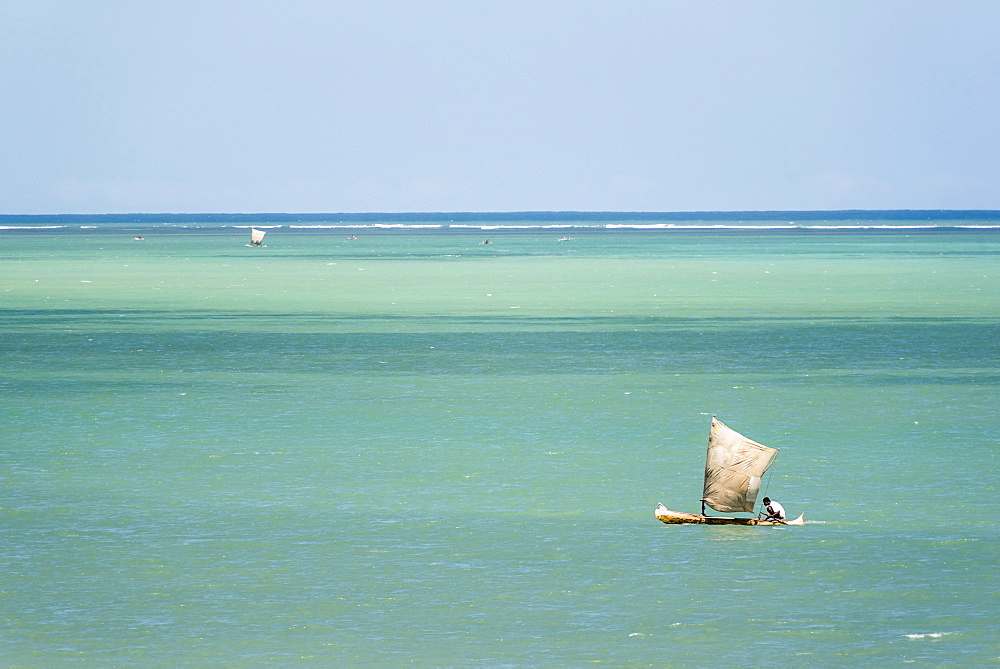 Fisherman fishing from a Pirogue, a traditional Madagascar sailing boat, Ifaty, Madagascar, Africa