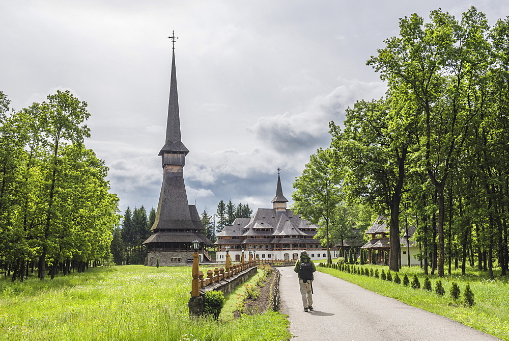 Tourist at Sapanta Peri Monastery, the tallest wooden church in the world, Maramures, Romania, Europe - 1109-2980
