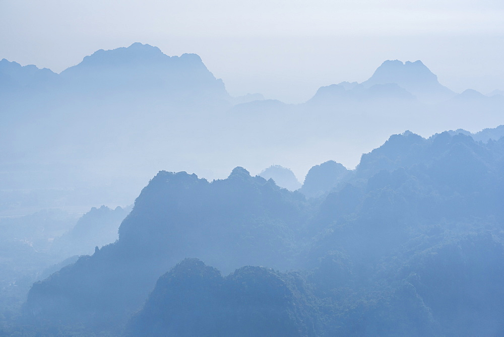 Misty limestone karst mountain landscape at sunrise, seen from Mount Zwegabin, Hpa An, Kayin State (Karen State), Myanmar (Burma), Asia