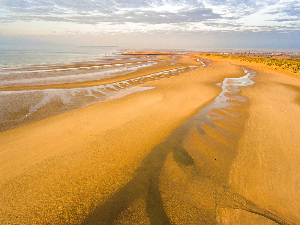Camber Sands Beach at sunrise, Camber, near Rye, East Sussex, England, United Kingdom, Europe (Drone)