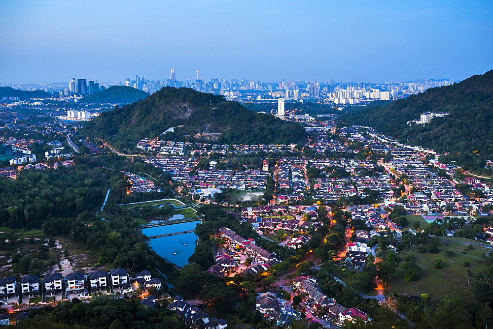 Kuala Lumpur skyline at night seen from Bukit Tabur Mountain, Malaysia