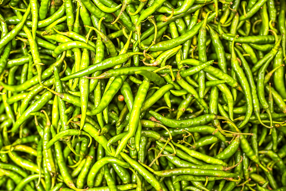 Green chillies for sale in Mapusa Market, Goa, India, Asia
