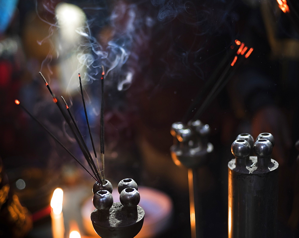 Incense burning at a Hindu temple in New Delhi, India, Asia