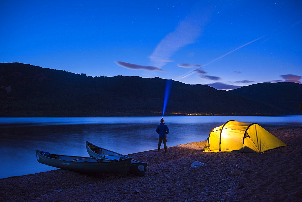 Camping at Loch Ness at night while canoeing the Caledonian Canal, Scottish Highlands, Scotland
