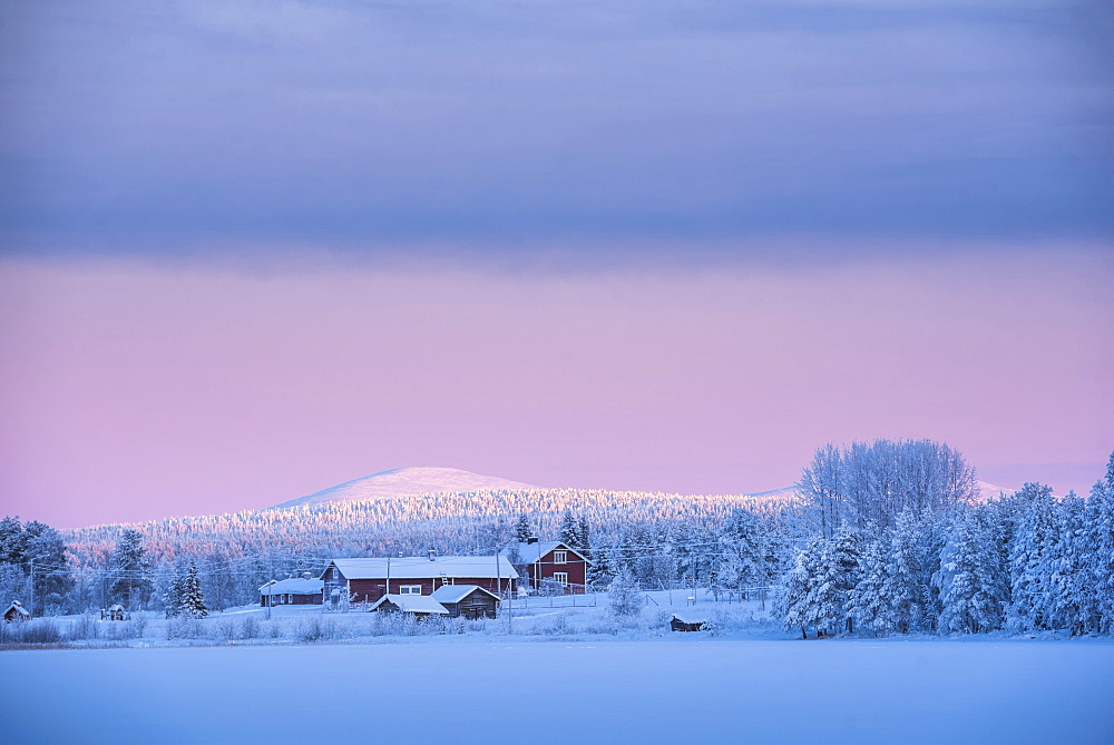 Sunrise on frozen Torassieppi Lake, Lapland, Finland, Europe