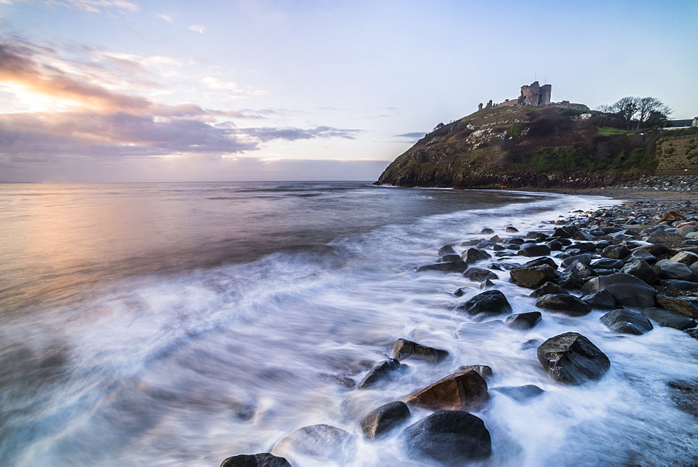 Criccieth Castle, above Criccieth Beach at sunrise, Gwynedd, North Wales, United Kingdom, Europe