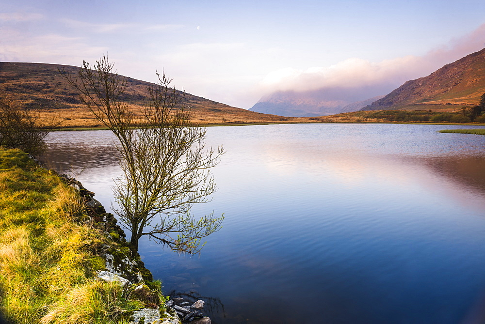 Lake at sunrise near the foot of Snowdon, Snowdonia National Park, North Wales, United Kingdom, Europe
