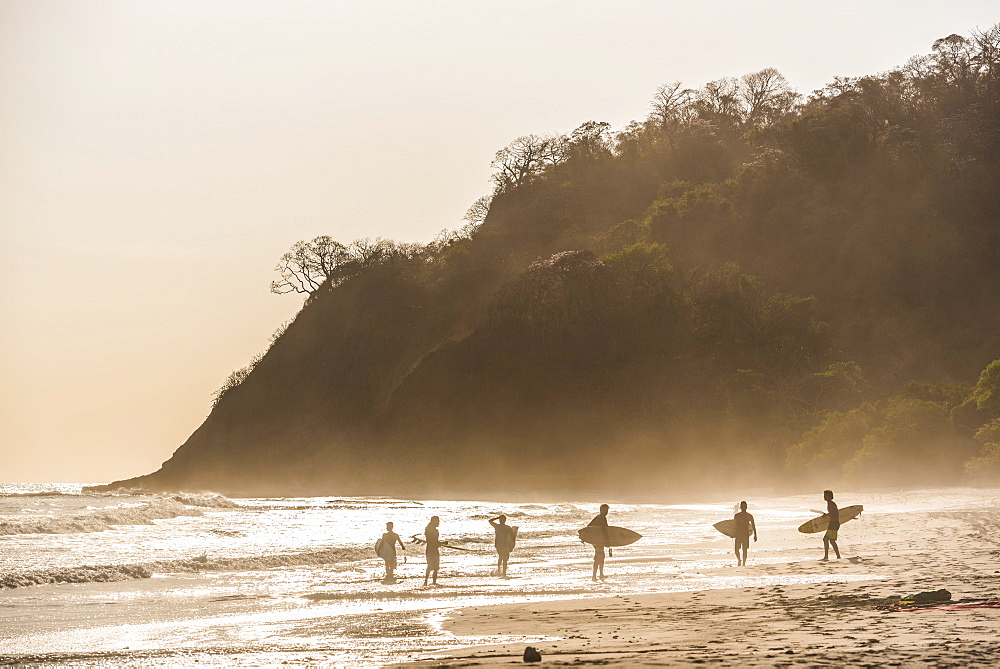 Surfers surfing on a beach at sunset, Nosara, Guanacaste Province, Pacific Coast, Costa Rica, Central America - 1109-3352