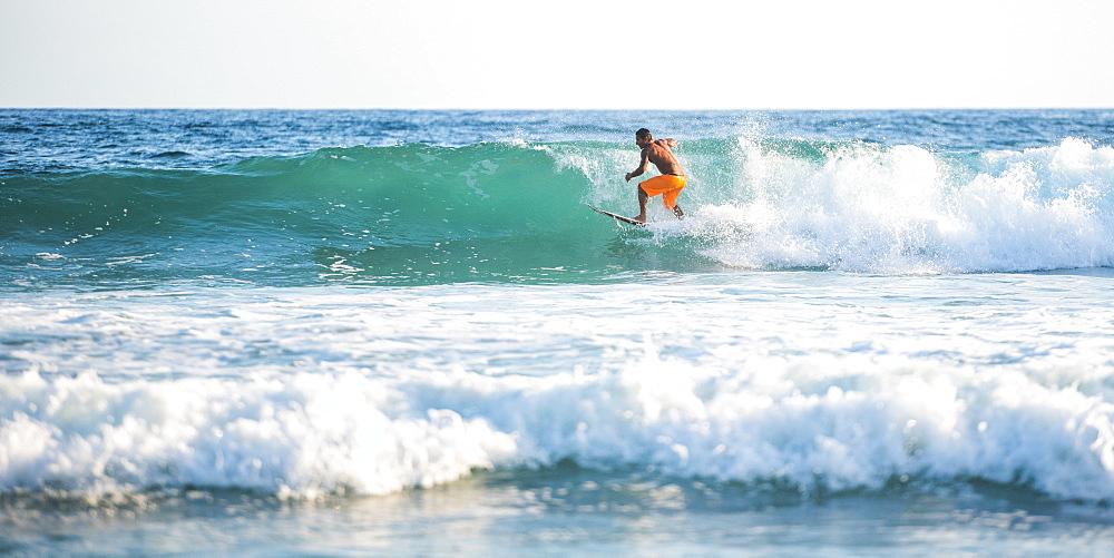 Surfers surfing on a beach, Nosara, Guanacaste Province, Pacific Coast, Costa Rica, Central America