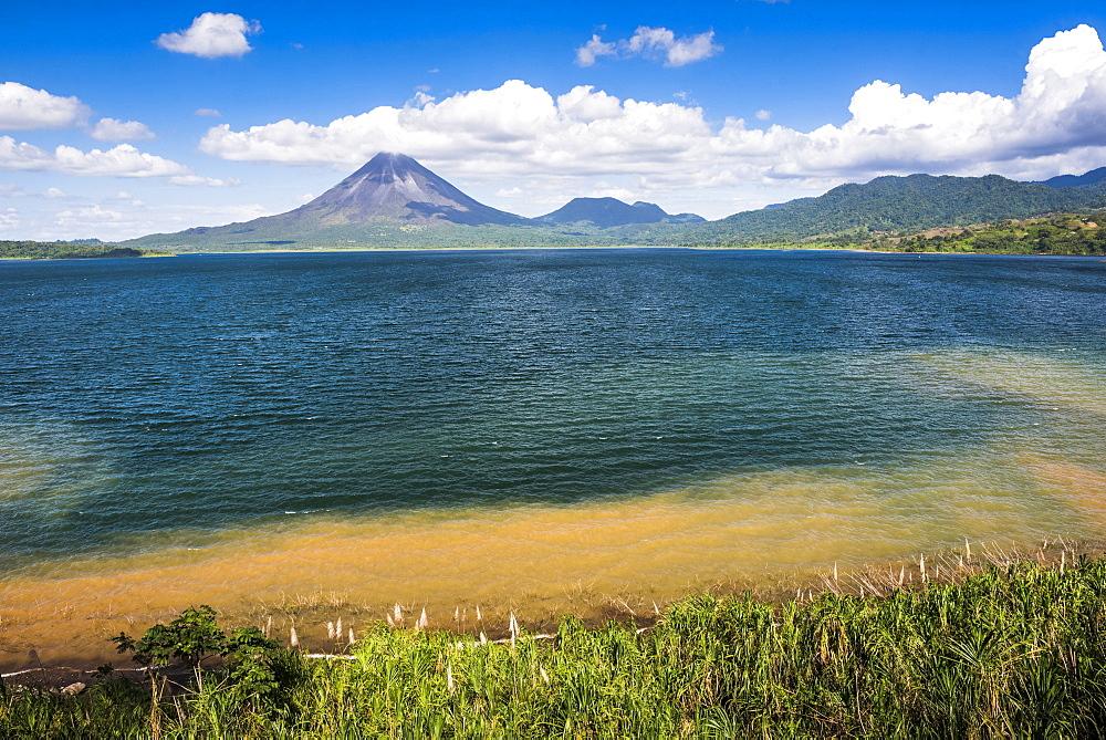 Arenal Volcano behind Laguna de Arenal (Arenal Lake), Alajuela Province, Costa Rica, Central America