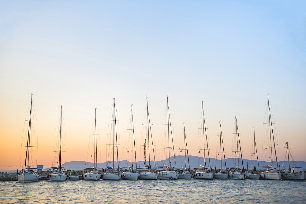 Sailing boats at sunset on Agistri Island, Saronic Islands, Greek Islands, Greece, Europe