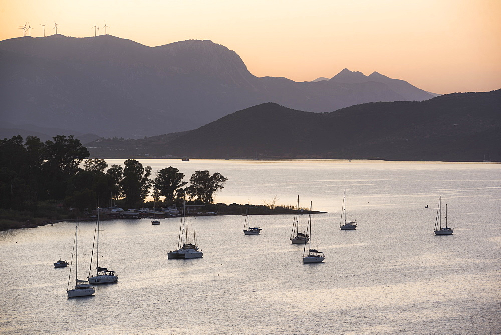 Sailing boats in Poros Island port at sunset, Saronic Island, Aegean Coast, Greek Islands, Greece, Europe