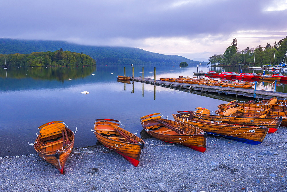 Rowing boats at Lake Windermere at sunset, Lake District National Park, Cumbria, England