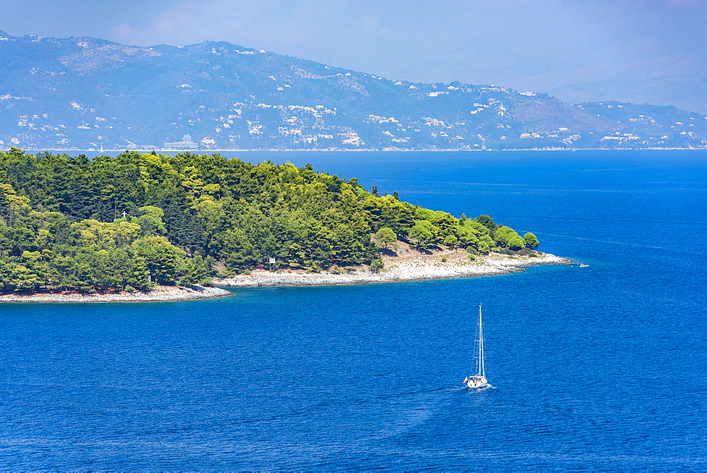Yacht sailing by Corfu, Greece, Europe