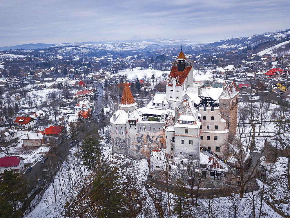 Bran Castle covered in snow in winter, Transylvania, Romania drone - 1109-3712