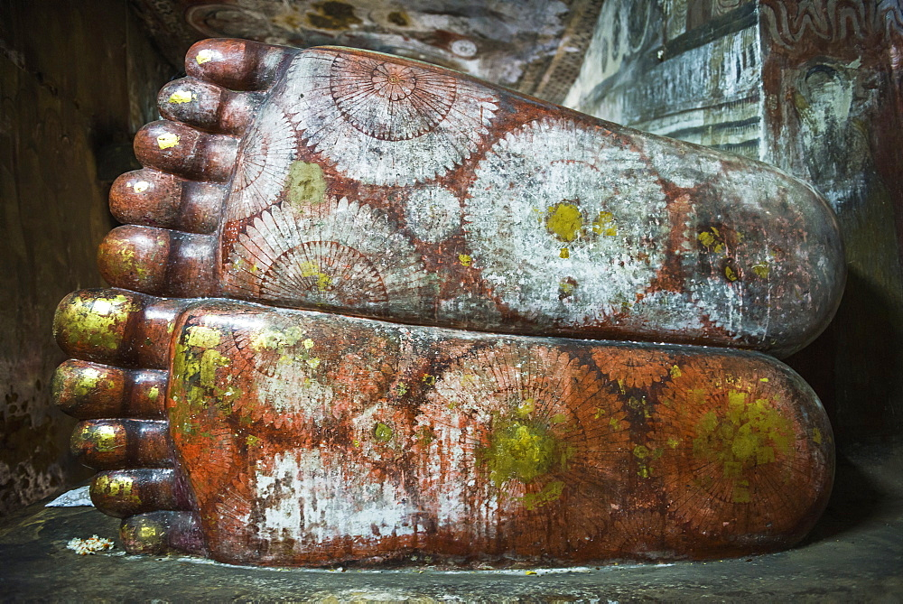Feet of the reclining Buddha in Cave 1 (Cave of the Divine King) (Temple of the Divine King), Dambulla Cave Temples, UNESCO World Heritage Site, Dambulla, Sri Lanka, Asia
