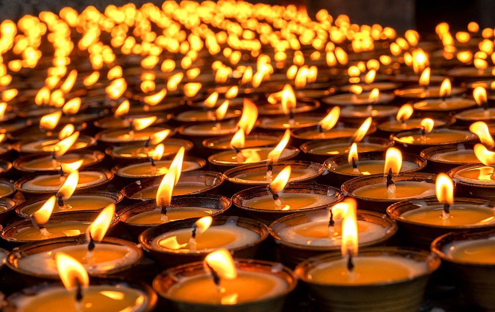 Candles lit for worship, Tamzhing Monastery, Bumthang District, Bhutan, Asia