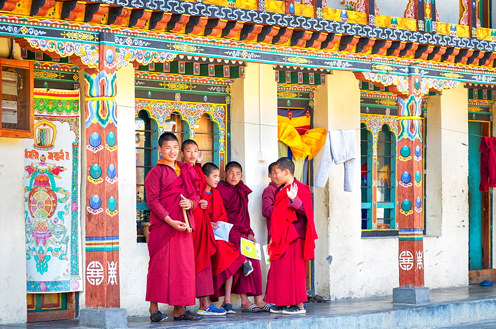 Novice monks in hillside monastery, Punakha, Bhutan, Asia