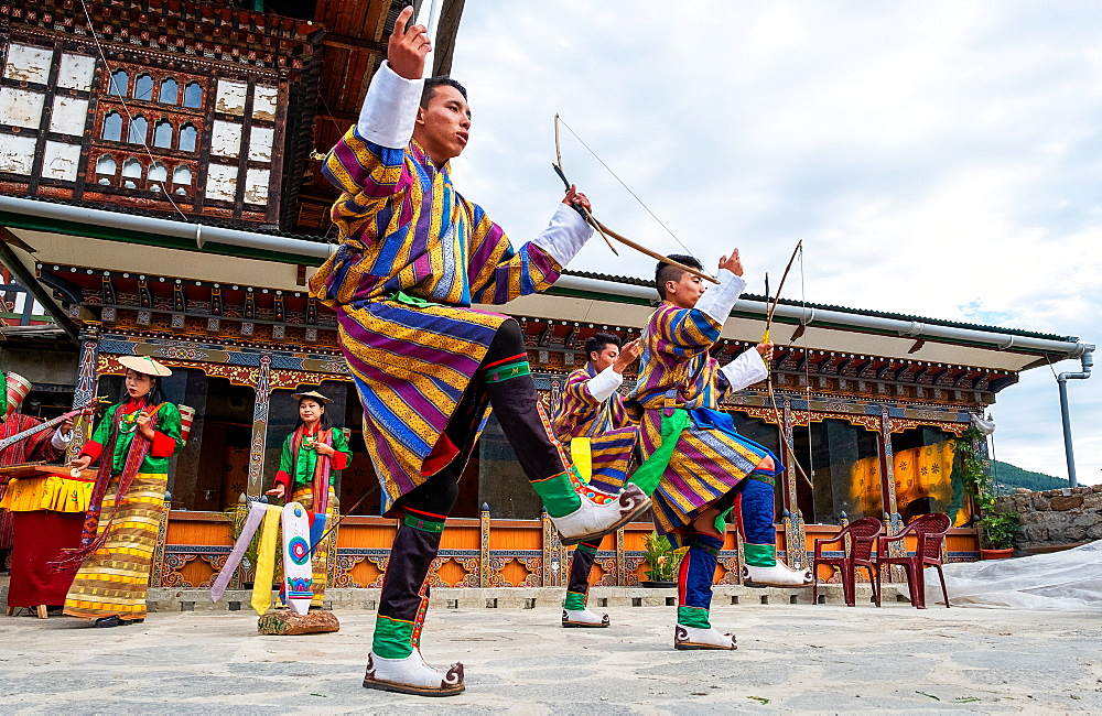 Bhutanese people performing the masked Cham Dance, Paro, Bhutan, Asia