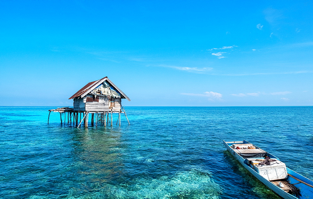 Huts built over the water by the Bajau Fishermen who live there three months of the year, Togian Islands, Indonesia, Southeast Asia, Asia - 1111-94