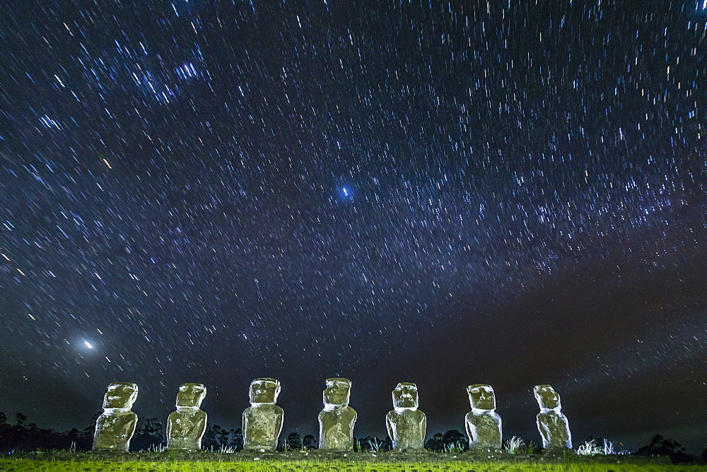 Seven Moai under the stars on a moonless night at Ahu Akivi on Easter Island (Isla de Pascua) (Rapa Nui), UNESCO World Heritage Site, Chile, South America