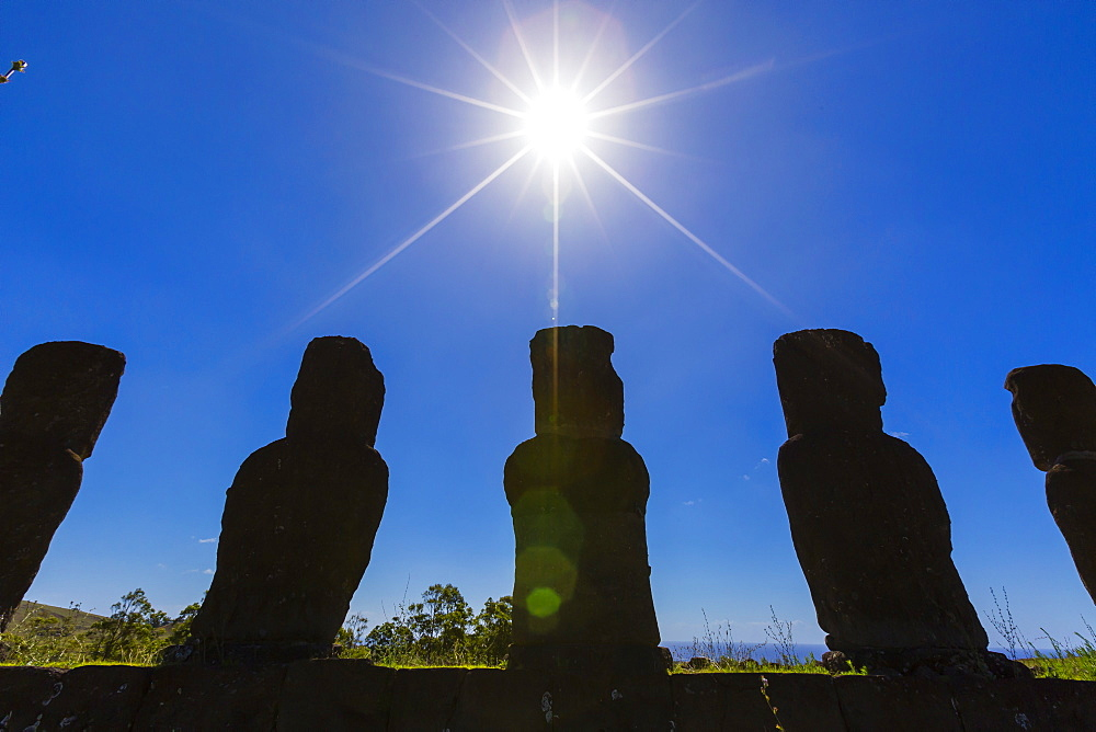 Detail of moai looking into the sun at Ahu Akivi, the first restored altar on Easter Island (Isla de Pascua) (Rapa Nui), UNESCO World Heritage Site, Chile, South America