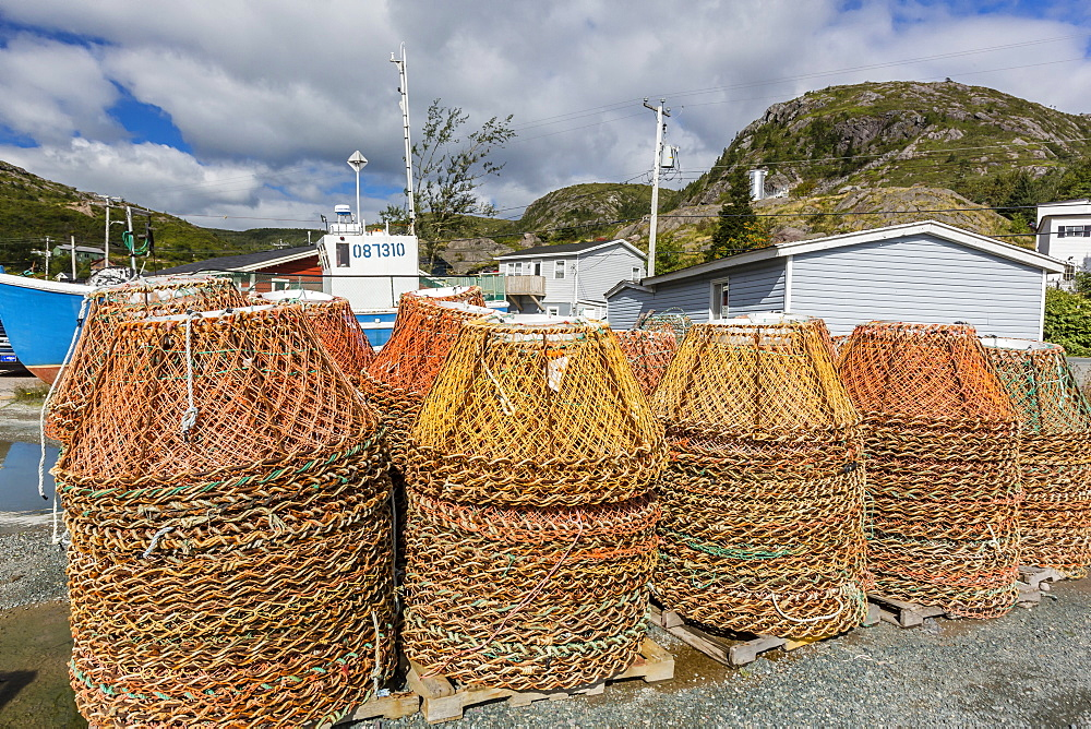 Lobster traps near fishing boat outside St. John's, Newfoundland, Canada, North America