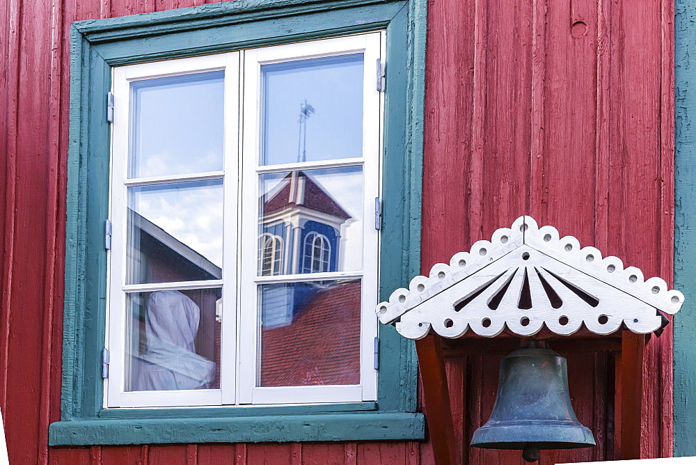 Brightly painted house reflected in window in Sisimiut, Greenland, Polar Regionscurve adjustments, boosted bluish shadows and rediish highlights