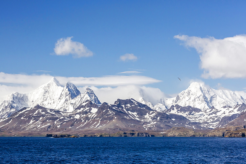 View of snow-capped mountains on approach to Stromness Harbor, South Georgia, UK Overseas Protectorate, Polar Regions