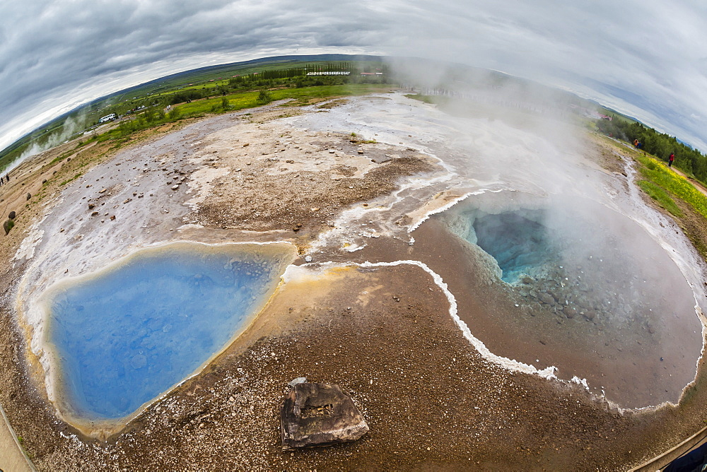 View of hot springs in the Haukadalur valley on the slopes of Laugarfjall hill, Iceland, Polar Regions