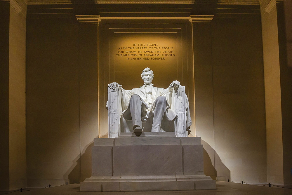 Interior of the Lincoln Memorial lit up at night, Washington D.C., United States of America, North America