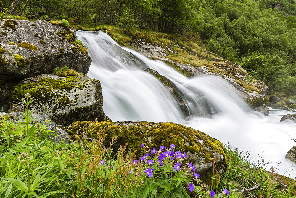 Slow shutter speed silky water of the Olden River as it flows along Briksdalen, Olden, Nordfjord, Norway, Scandinavia, Europe