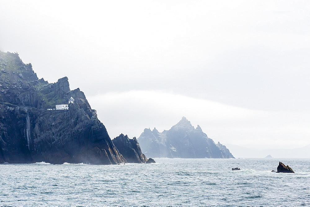 Fog shrouds the Skellig Islands, Great Skellig Michael in the foreground, Little Skellig behind, County Kerry, Munster, Irish Sea, Republic of Ireland, Europe