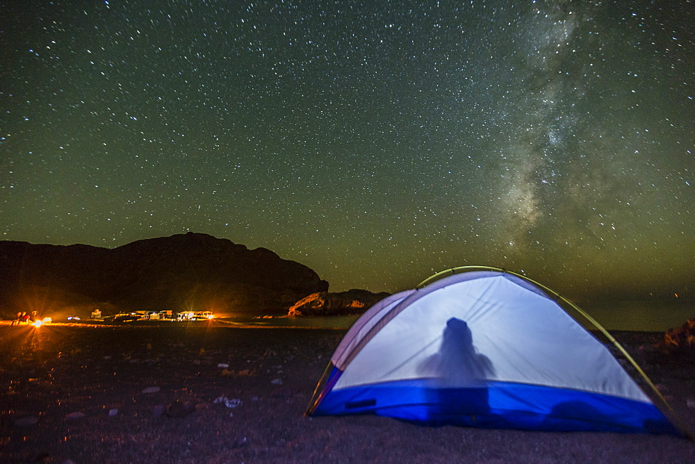 Night view of the Milky Way with lit up tent in foreground, Himalaya Beach, Sonora, Mexico, North America