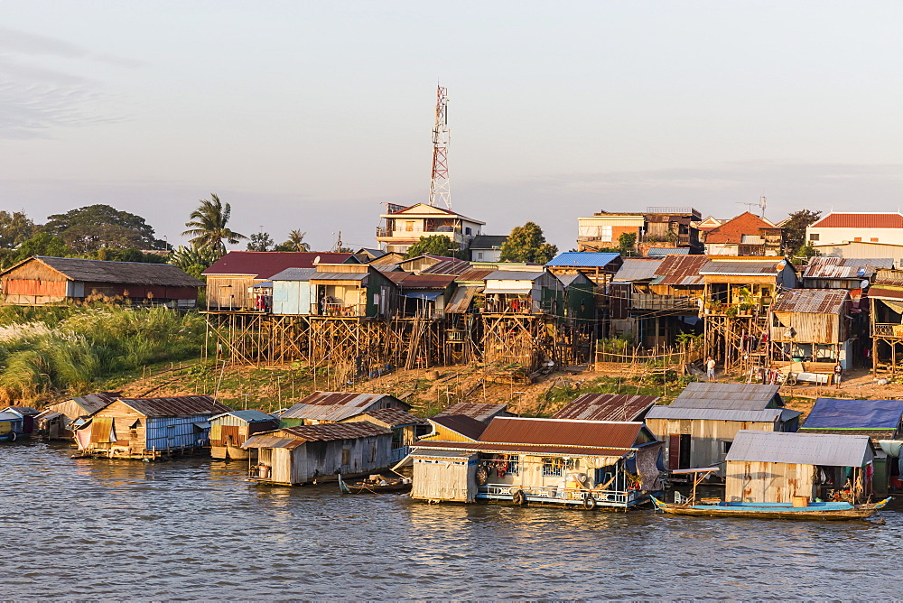 Life along the Mekong River approaching the capital city of Phnom Penh, Cambodia, Indochina, Southeast Asia, Asia