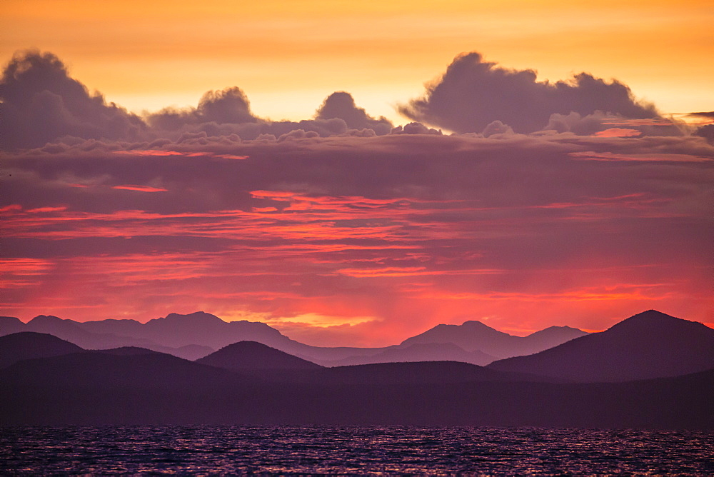 Intense clouds and sunset over Baja Peninsula from Isla Ildefonso, Baja California Sur, Mexico, North America