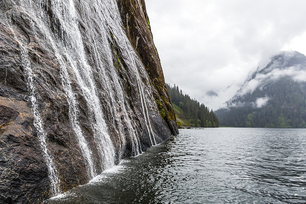 Water cascading down cliffs in Misty Fjord National Park, Alaska, United States of America, North America