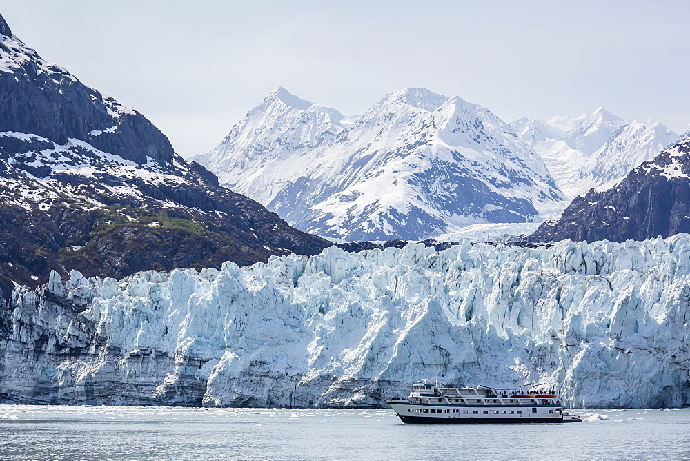 A tourist ship explores the Lamplugh Glacier in Glacier Bay National Park and Preserve, southeast Alaska, United States of America, North America